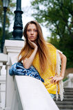 Street city fashion redheaded girl with long hair stock photography