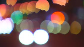 Street city at night. Blur. Moving colored circles and spots resulting blur of night street stock video