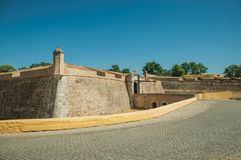 Street at the city wall with an entrance and small bridge royalty free stock photo