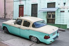 Street with classic american car - Taxi - Santiago de Cuba Stock Images