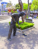 Bronze statue of a street cleaner Stock Images