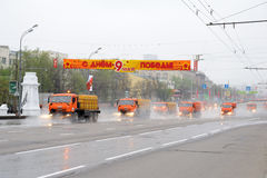 Street cleaning. Big orange street cleansing machines wash the asphalt road before the Victory day military Parade May 07, 2011 in Moscow, Russia Royalty Free Stock Photography