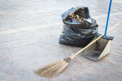 Street cleaning - broom, rubbish bag and dustpan Stock Images