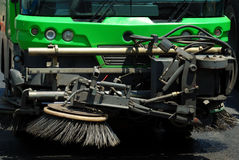 Street cleaning machine. A green street cleaning machine Royalty Free Stock Images