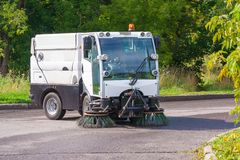 Street cleaning machine. In the park Stock Photo
