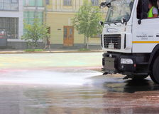 Street cleaning watering machine Royalty Free Stock Photo