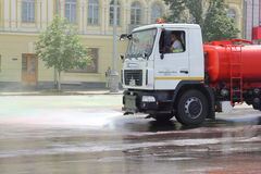 Street cleaning watering machine Stock Images
