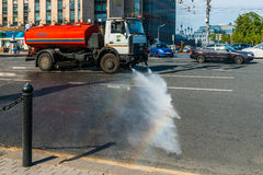 Street cleansing machine waters Tverskaya street Royalty Free Stock Images