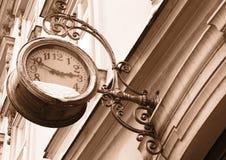 Street clock. Shot of street clock in the city. Sepia Royalty Free Stock Photo