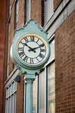 Street Clock. Green Street Clock with Roman Numberal Numbers Royalty Free Stock Photography
