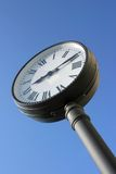 Street clock. Against blue sky with copy space Royalty Free Stock Images