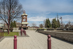 Street clock. Against blue sky with trees in apublic place Royalty Free Stock Photo