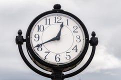 Street Clock. Against an overcast Sky Royalty Free Stock Photos