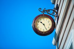 Street clock on the background of blue sky. Street clock on the background Stock Image