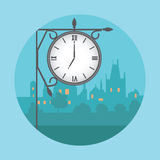 Street clock in the background of night city. Royalty Free Stock Photo