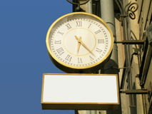 Street clock with the blank advertisement place Royalty Free Stock Image