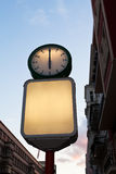 Street clock and blank advertising billboard Stock Images
