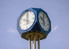 Street clock with blue sky in background stock photo