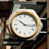 Street clock. On building wall Royalty Free Stock Photo
