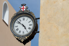 Street clock on building wall Stock Image