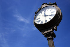 Street Clock in Downtown Plano, TX. Traditional style round street clock showing 4 o'clock Stock Photos