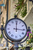 Street clock. A good example of a street clock that operates somewhat historic, on the other hand, is a romantic and useful in their size and simplicity Royalty Free Stock Image