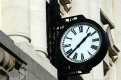 Street clock. Hang on a wall of a train station  building Royalty Free Stock Photo