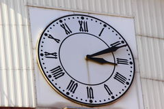 Street clock. Hanging on a white wall clock white Royalty Free Stock Photography