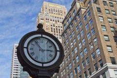 Street clock at the Manhattan. Stock Photos