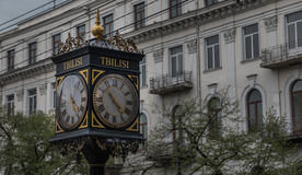 Street Clock. A picture of a street clock in one of the busiest Tbilisi streets Royalty Free Stock Photo