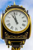 Street Clock. Vintage street clock against the sky Stock Image