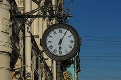 Street clock. On the wall Royalty Free Stock Photos
