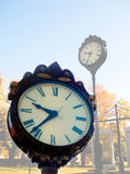 Street clocks. Old, analogue, street or outdoor clocks.  Theme:  time Royalty Free Stock Image