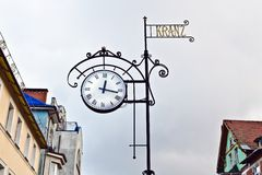 Street clocks, Zelenogradsk (before 1946 Cranz), Kaliningrad oblast, Russia. Street clock on the background of the roofs of the old houses. Zelenogradsk (before royalty free stock image