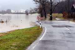 Flooding. Street closed because of flooding due to snow melt stock photos