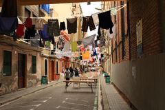 Street with clothes in Barcelona Stock Photo