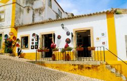 Small Art Crafts Store at Obidos Village, Small Typical House, Artisanal Craft. Street with cobblestone ground and a small typical portuguese house, which is royalty free stock photo