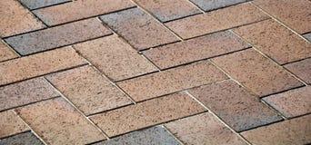 Street cobblestones, background street paving blocks. Street cobblestones, background street paving blocks in brown tones Royalty Free Stock Photo