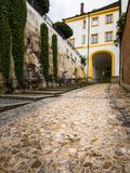 Street with Cobblestones in Freising. Street with cobblestones leading from the center of Freising up to the Domberg Stock Photo