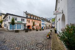Street with cobblestones in the old city of Saarburg, Germany stock images