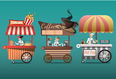 Street coffee cart, popcorn and hotdog shop with sellers. Young people buy street food or junk food in food festival event Royalty Free Stock Photo