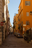 Street by Colloseo. Sunny day in rome with the colloseom in center Royalty Free Stock Images