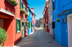 Street with colorful buildings in Burano island, Venice Stock Photos