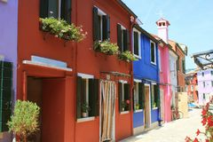 Street with colorful buildings in Burano island, Venice, Italy royalty free stock image