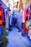 Street with colorful clothing, Chefchaouen, Morocco Stock Images