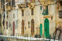Street with colorful gates in Vallatta. Historical center in Malta Stock Images