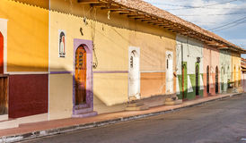 Street with colorful houses in Granada stock photos