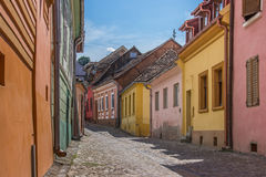 Street with colorful houses in Sighisoara Royalty Free Stock Photography