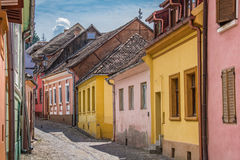 Street with colorful houses in Sighisoara Stock Photography