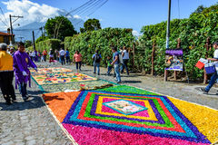 Street of colorful Lent carpets & volcano, Antigua, Guatemala stock photography